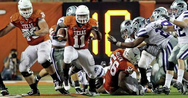 UT running back Cody Johnson blows through a big hole for a long gain to set up a fourth quarter scoring try as Texas plays Kansas State at Royal Stadium  on November 19, 2011.  Tom Reel/Staff Photo: TOM REEL, Express-News / © 2011 San Antonio Express-News