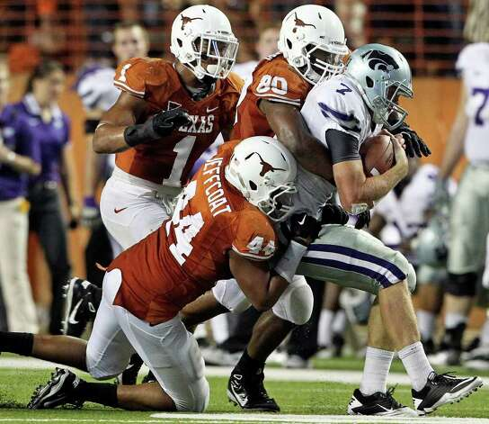 SPORTS   The Longhorn defense sacks Collin Klein in the fourth quarter as Texas plays Kansas State at Royal Stadium  on November 19, 2011.  Tom Reel/Staff Photo: TOM REEL, Express-News / © 2011 San Antonio Express-News