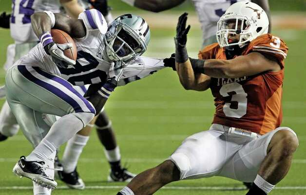 SPORTS   Longhorn defender Jordan Hicks brings down Torell Miller on a pass to the side as Texas plays Kansas State at Royal Stadium  on November 19, 2011.  Tom Reel/Staff Photo: TOM REEL, Express-News / © 2011 San Antonio Express-News