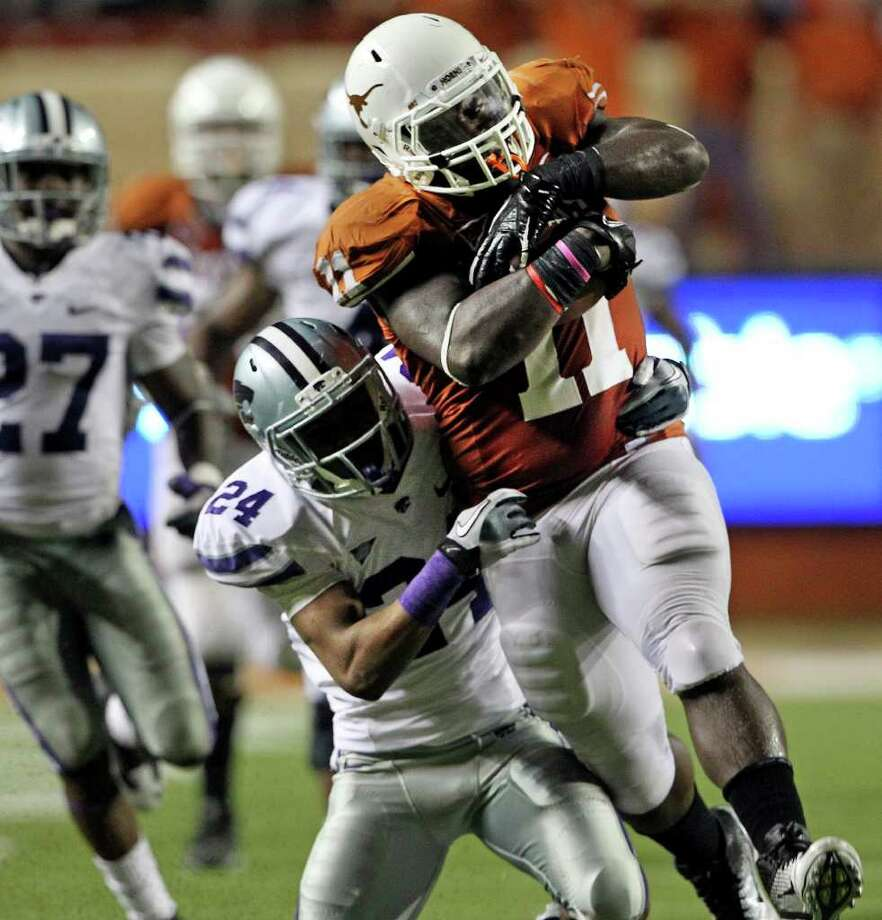SPORTS   UT running back Cody Johnson hammers out a long run setting up the Longhorns for a fourth quarter scoring try as Texas plays Kansas State at Royal Stadium  on November 19, 2011.  Tom Reel/Staff Photo: TOM REEL, Express-News / © 2011 San Antonio Express-News