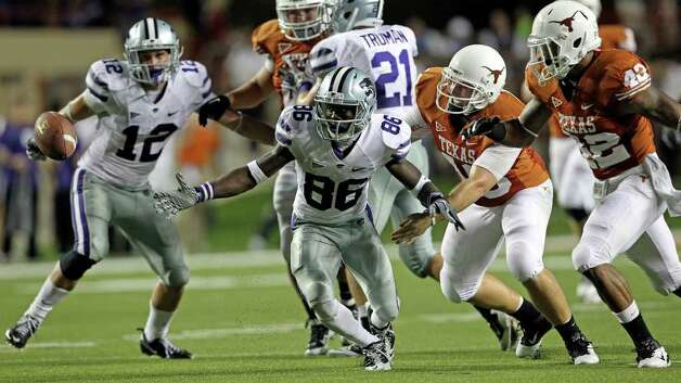 SPORTS   Kansas State return specialist Tramaine Thompson scrambles to get back to the ball after missing the catch on a punt as Texas plays Kansas State at Royal Stadium  on November 19, 2011.  Tom Reel/Staff Photo: TOM REEL, Express-News / © 2011 San Antonio Express-News