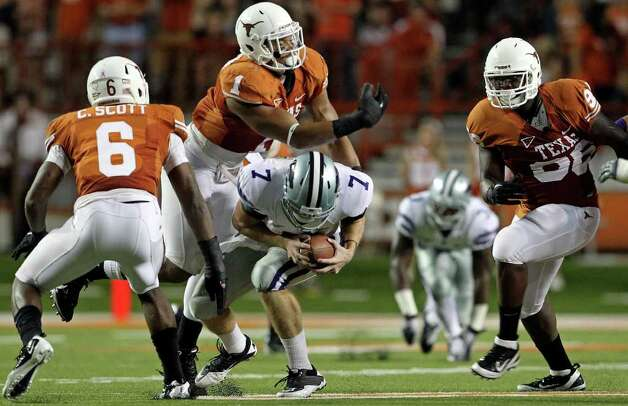 SPORTS   Kansas State quarterback Collin Klein goes down after being whacked by UT linebacker Keenan Robinson as Texas plays Kansas State at Royal Stadium  on November 19, 2011.  Tom Reel/Staff Photo: TOM REEL, Express-News / © 2011 San Antonio Express-News