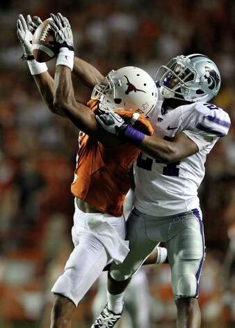 SPORTS   UT receiver Mike Davis is prevented from catching a long pass from David Ash in the second quarter by Kansas State defensive back Nigel Malone as Texas plays Kansas State at Royal Stadium  on November 19, 2011.  Tom Reel/Staff Photo: TOM REEL, Express-News / © 2011 San Antonio Express-News