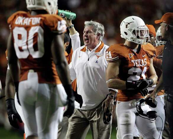 SPORTS   Mack Brown encourages his players during a timeout in the first half as Texas plays Kansas State at Royal Stadium  on November 19, 2011.  Tom Reel/Staff Photo: TOM REEL, Express-News / © 2011 San Antonio Express-News