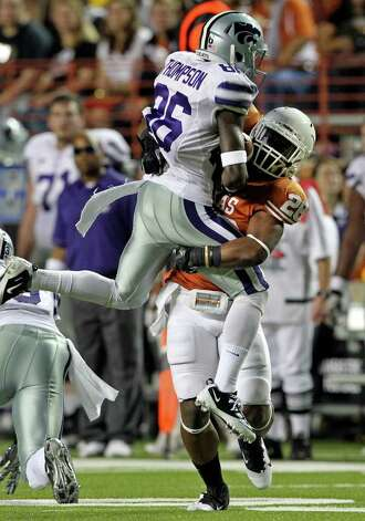 SPORTS   UT defender Quandre Diggs uproots Kansas State receiver Tramaine Thompson in the first quarter as Texas plays Kansas State at Royal Stadium  on November 19, 2011.  Tom Reel/Staff Photo: TOM REEL, Express-News / © 2011 San Antonio Express-News