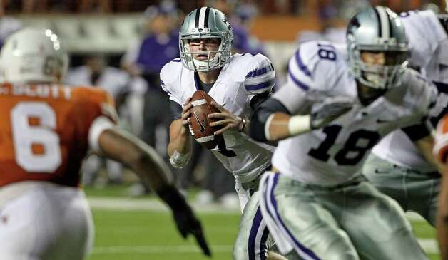 SPORTS  Kansas State quarterback Collin Klein rolls out looking for a receiver as  Texas plays Kansas State at Royal Stadium  on November 19, 2011.  Tom Reel/Staff Photo: TOM REEL, Express-News / © 2011 San Antonio Express-News