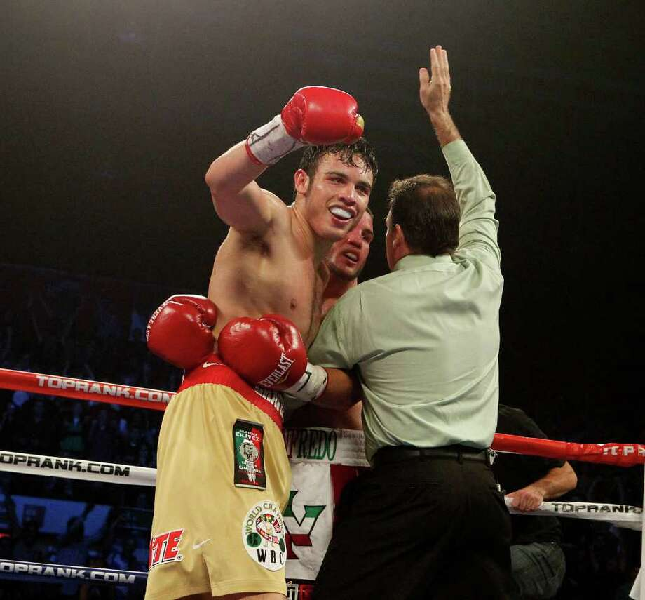 Julio Cesar Chavez, Jr. holds his hand in the after defeating Peter Manfredo, Jr. on Saturday during HBO's Boxing After Dark at Reliant Arena. Chavez won the fight in the fifth round by TKO. Photo: James Nielsen, Chronicle / © 2011 Houston Chronicle