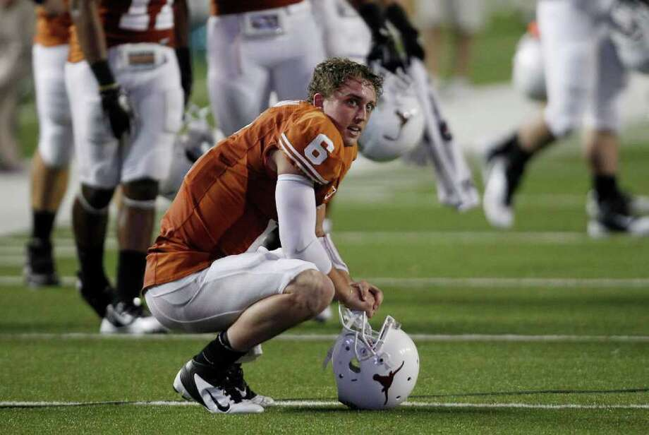 Texas' Case McCoy is seen on the field at the end of an NCAA college football game against Kansas State, Saturday, Nov. 19, 2011, in Austin, Texas. Kansas State won 17-13. (AP Photo/Eric Gay) Photo: Eric Gay, Associated Press / AP