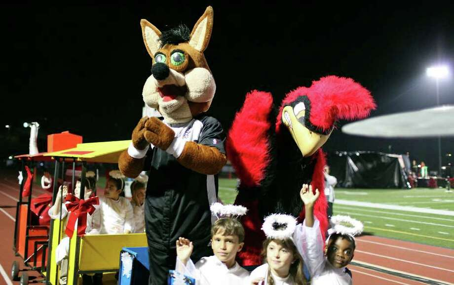 FOR METRO - The Spurs Coyote, University of the Incarnate Word Cardinal and others ride around Benson Stadium during the University of the Incarnate Word's 25th Annual Light the Way celebration held Saturday Nov. 19, 2011 on the campus. (PHOTO BY EDWARD A. ORNELAS/eaornelas@express-news.net) Photo: EDWARD A. ORNELAS, SAN ANTONIO EXPRESS-NEWS / © SAN ANTONIO EXPRESS-NEWS (NFS)