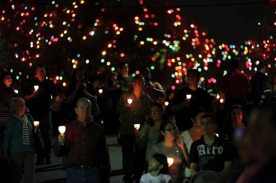 FOR METRO - People take part in the candlelight procession part of the University of the Incarnate Word's 25th Annual Light the Way celebration held Saturday Nov. 19, 2011 on the campus. (PHOTO BY EDWARD A. ORNELAS/eaornelas@express-news.net) Photo: EDWARD A. ORNELAS, SAN ANTONIO EXPRESS-NEWS / © SAN ANTONIO EXPRESS-NEWS (NFS)