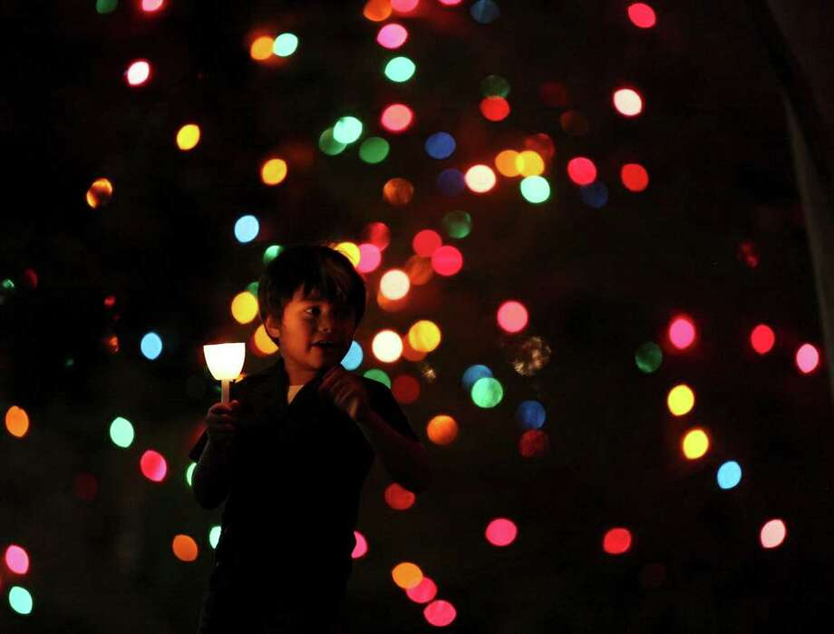 FOR METRO - Rafael Garcia-Gallegos, 5,  takes in the sights while attending the University of the Incarnate Word's 25th Annual Light the Way celebration held Saturday Nov. 19, 2011 on the campus. (PHOTO BY EDWARD A. ORNELAS/eaornelas@express-news.net) Photo: EDWARD A. ORNELAS, SAN ANTONIO EXPRESS-NEWS / © SAN ANTONIO EXPRESS-NEWS (NFS)