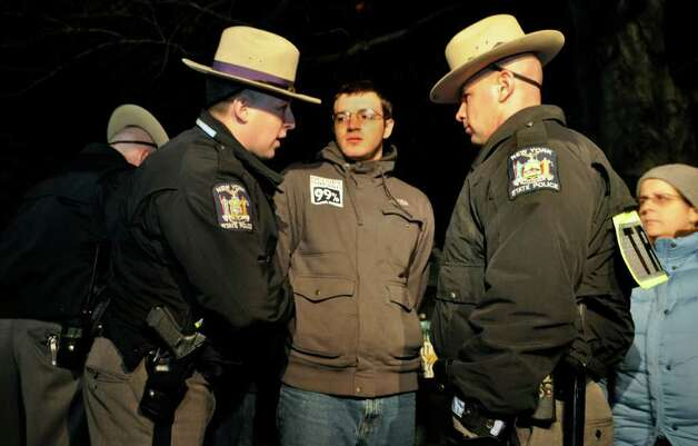 An Occupy Albany protester is arrested by New York State Troopers, along with several other protesters who violated an 11 p.m. curfew in state-run Lafayette Park, which is located across Washington Avenue from the state Capitol in Albany on Saturday, Nov. 19, 2011. Photo: Stewart Cairns, AP / FR112526AP