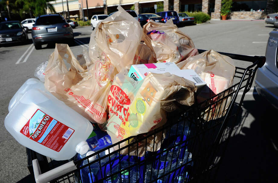 Time to give up the plastic habit? The Seattle City Council has proposed a ban on plastic shopping bags. Photo: Getty Images. / 2010 Getty Images