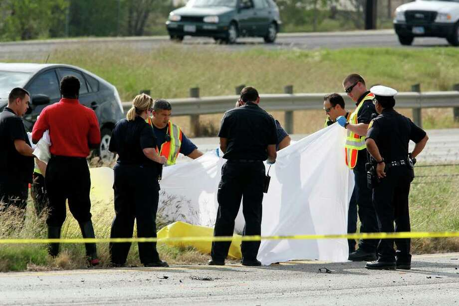 Emergency personnel work the scene of a two fatality rollover accident Sunday Nov. 20, 2011 on SE Loop 410 between Roosevelt Ave. and Moursund Blvd. Photo: EDWARD A. ORNELAS, SAN ANTONIO EXPRESS-NEWS / © SAN ANTONIO EXPRESS-NEWS (NFS)