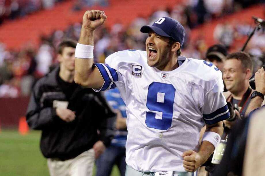 LANDOVER, MD - NOVEMBER 20:  Tony Romo #9 of the Dallas Cowboys celebrates while running off the field after the Cowboys defeated the Washington Redskins 27-24 in overtime at FedExField on November 20, 2011 in Landover, Maryland. Photo: Rob Carr, Getty / 2011 Getty Images