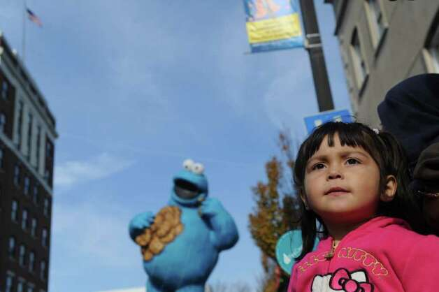 Eva Palacios, 3, watches the UBS Parade Spectacular along with tens of thousands of others in downtown Stamford, Conn., Sunday, November 20, 2011. The most welcome guest, though, was the clear skies and temperatures in the low 60s. Photo: Keelin Daly