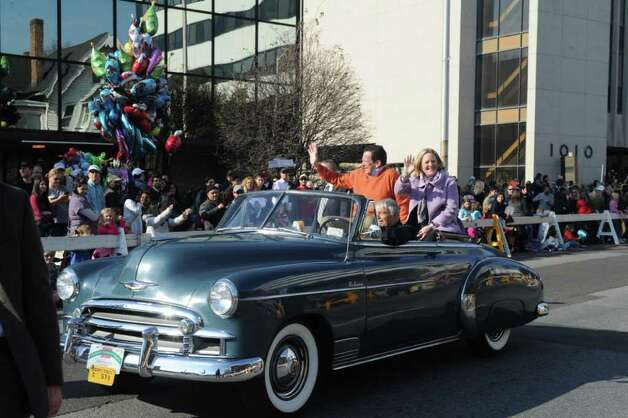 Connecticut Governor Dannel P. Malloy and his wife, Cathy, participate in the UBS Parade Spectacular which welcomed tens of thousands to downtown Stamford Sunday, November 20, 2011. The most welcome guest, though, was the clear skies and temperatures in the low 60s. Photo: Keelin Daly