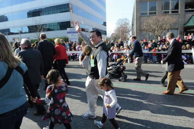 Representative William Tong marches as the UBS Parade Spectacular welcomed tens of thousands to downtown Stamford Sunday, November 20, 2011. The most welcome guest, though, was the clear skies and temperatures in the low 60s. Photo: Keelin Daly