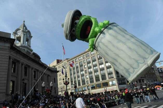 "Oscar the Grouch moves past the Old Town Hall during Stamford's UBS Parade Spectacular, featuring 21 balloons, marching bands and the cast of Showtime's ""The Big C,"" makes its way through Stamford, Conn., November 20, 2011. Photo: Keelin Daly"