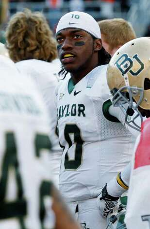 Baylor quarterback Robert Griffin III looks up at the scoreboard during the fourth quarter of an NCAA college football game against Oklahoma State in Stillwater, Okla., Saturday, Oct. 29, 2011. Oklahoma State won 59-24. Photo: AP