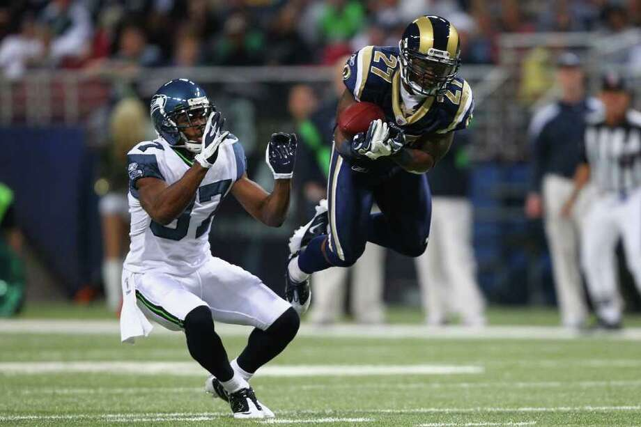 ST. LOUIS, MO - NOVEMBER 20: Quintin Mikell #27 of the St. Louis Rams intercepts a pass intended for Ben Obomanu #87 of the Seattle Seahawks at the Edward Jones Dome on November 20, 2011 in St. Louis, Missouri. Photo: Dilip Vishwanat, Getty Images / 2011 Getty Images