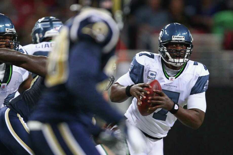 ST. LOUIS, MO - NOVEMBER 20: Tarvaris Jackson #7 of the Seattle Seahawks looks to pass the ball against the St. Louis Rams at the Edward Jones Dome on November 20, 2011 in St. Louis, Missouri. Photo: Dilip Vishwanat, Getty Images / 2011 Getty Images