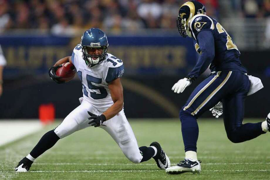 ST. LOUIS, MO - NOVEMBER 20: Doug Baldwin #15 of the Seattle Seahawks catches a pass against the St. Louis Rams at the Edward Jones Dome on November 20, 2011 in St. Louis, Missouri. Photo: Dilip Vishwanat, Getty Images / 2011 Getty Images