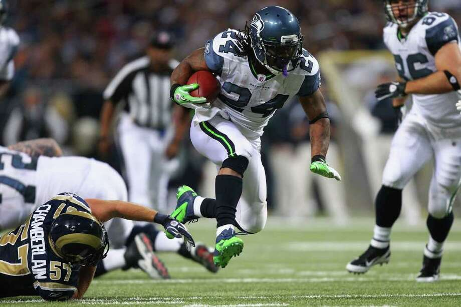 ST. LOUIS, MO - NOVEMBER 20: Marshawn Lynch #24 of the Seattle Seahawks rushes against the St. Louis Rams at the Edward Jones Dome on November 20, 2011 in St. Louis, Missouri. Photo: Dilip Vishwanat, Getty Images / 2011 Getty Images
