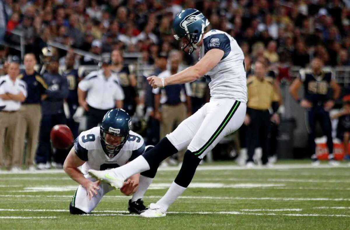 ST. LOUIS, MISSOURI - NOVEMBER 20: Seattle Seahawks place kicker Steven Hauschka #4 kicks against the St. Louis Rams for a field goal in the first half of the game November 20, 2011 at the Edward Jones Dome in St. Louis, Missouri.