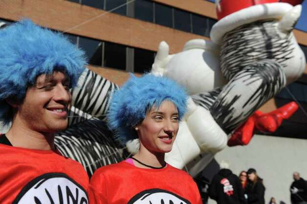 Billy Carrigan and Madison Cahn bring Thing 1 and Thing 2 to life as they parade with the Cat in the Hat as the UBS Parade Spectacular welcomed tens of thousands to downtown Stamford Sunday, November 20, 2011. The most welcome guest, though, was the clear skies and temperatures in the low 60s. Photo: Keelin Daly