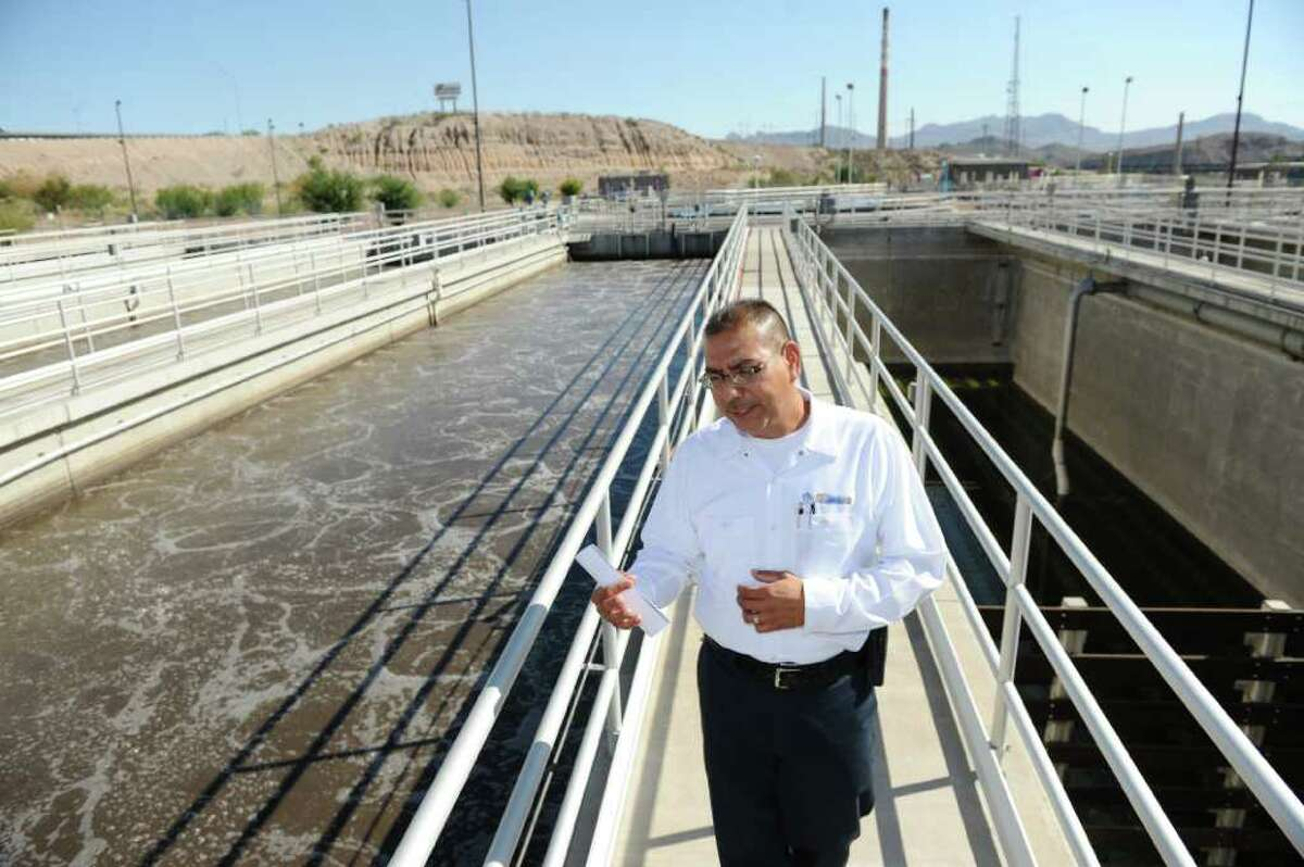 Fred Murillo, plant superintendent for the Northwest Wastewater Treatment Plant in El Paso, points out waste water being treated by the plant. The plant takes a portion of the water it treats and uses it for irrigating local golf courses and high schools as a way for the city to save on water usage. Local companies can also buy the non-drinkable water for similar uses.Read weather.com's report on El Paso's water woes.