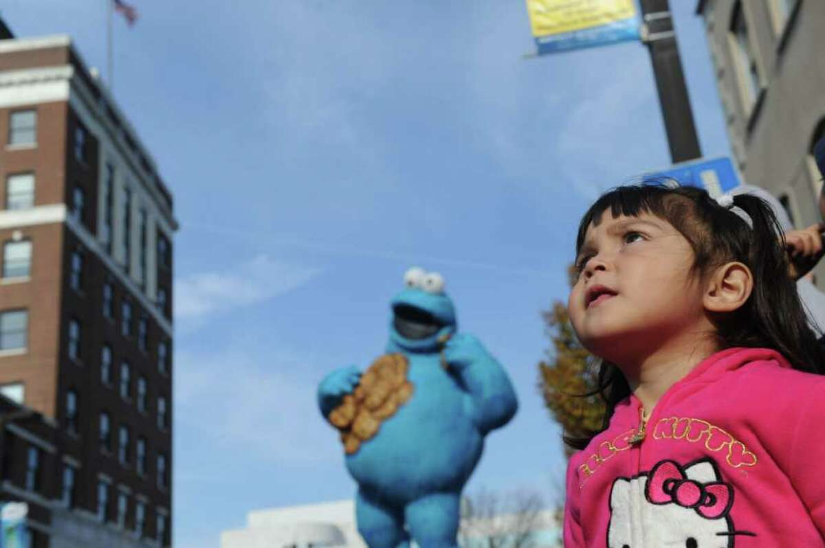 Eva Palacios, 3, watches as the Cookie Monster floats along as the UBS Parade Spectacular draws with tens of thousands to downtown Stamford, Conn., Sunday, November 20, 2011. The most welcome guest, though, was the clear skies and temperatures in the low 60s.