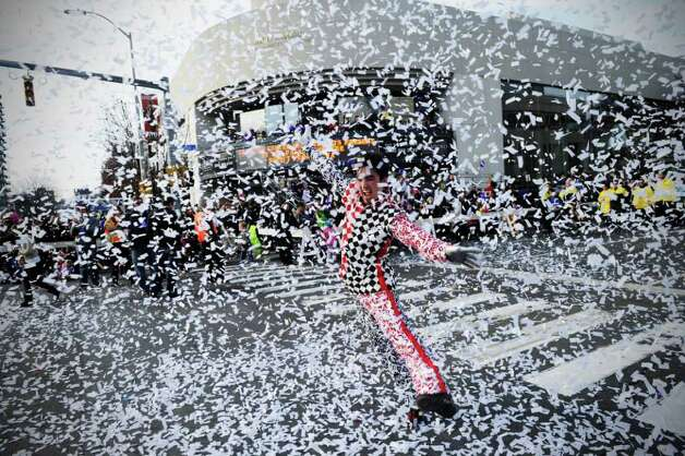A Cirque-tacular performer dances in a blast of confetti as the UBS Parade Spectacular welcomed tens of thousands to downtown Stamford Sunday, November 20, 2011. The most welcome guest, though, was the clear skies and temperatures in the low 60s. Photo: Keelin Daly