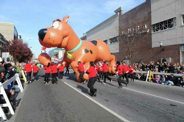 "Scooby-Doo! floats through downtown as Stamford's UBS Parade Spectacular, featuring 21 balloons, marching bands and the cast of Showtime's ""The Big C,"" makes its way through Stamford, Conn., November 20, 2011. Photo: Keelin Daly"