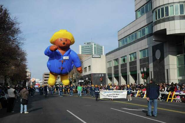 "Paddington Bear floats through downtown as Stamford's UBS Parade Spectacular, featuring 21 balloons, marching bands and the cast of Showtime's ""The Big C,"" makes its way through Stamford, Conn., November 20, 2011. Photo: Keelin Daly"