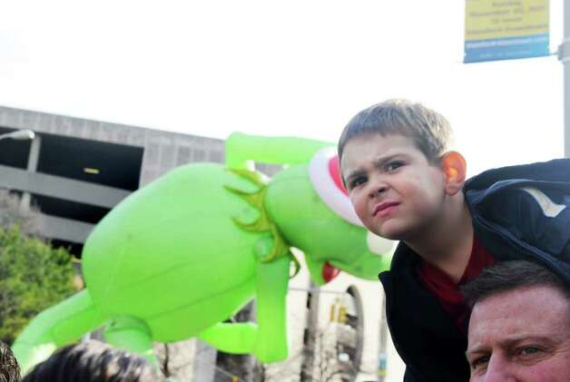 Mason Connelly, 5, watches as Kermit the Frog moves by as the UBS Parade Spectacular welcomed tens of thousands to downtown Stamford Sunday, November 20, 2011. The most welcome guest, though, was the clear skies and temperatures in the low 60s. Photo: Keelin Daly