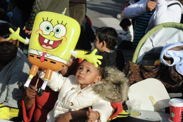 Autumn DeLeon, 1, watches as the UBS Parade Spectacular welcomed tens of thousands to downtown Stamford Sunday, November 20, 2011. The most welcome guest, though, was the clear skies and temperatures in the low 60s. Photo: Keelin Daly