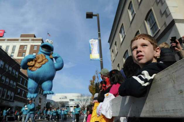 "Matthew Debes, 6, watches as the Cookie Monster closes in as Stamford's UBS Parade Spectacular, featuring 21 balloons, marching bands and the cast of Showtime's ""The Big C,"" makes its way through Stamford, Conn., November 20, 2011. Photo: Keelin Daly"