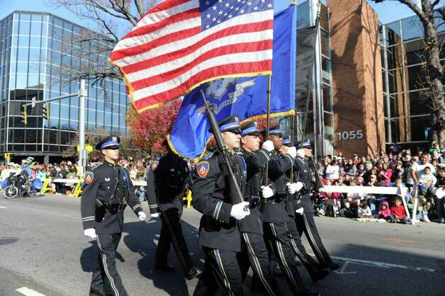 The Stamford Police march in the UBS Parade Spectacular welcomed tens of thousands to downtown Stamford Sunday, November 20, 2011. The most welcome guest, though, was the clear skies and temperatures in the low 60s. Photo: Keelin Daly