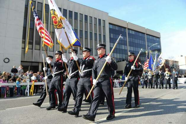 Stamford Fire Fighters march as the UBS Parade Spectacular welcomed tens of thousands to downtown Stamford Sunday, November 20, 2011. The most welcome guest, though, was the clear skies and temperatures in the low 60s. Photo: Keelin Daly