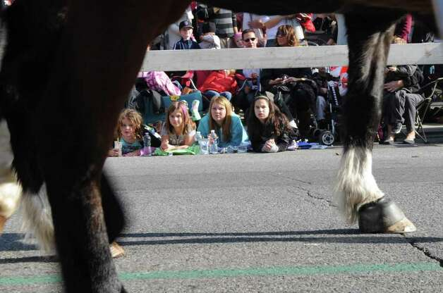 From left, Jade Constantine, 8, Makayla Hulton, 8, Janie Hulton, 11, and Christina Emmerthal, 11, watch as the The Second Company Governor's Horse Guard passes by as the UBS Parade Spectacular welcomed tens of thousands to downtown Stamford Sunday, November 20, 2011. The most welcome guest, though, was the clear skies and temperatures in the low 60s. Photo: Keelin Daly
