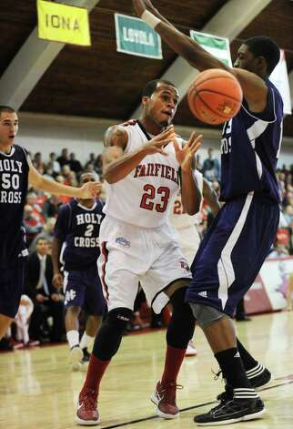 Fairfield's Jamel Fields makes a baseline pass during the Stags' victory over Holy Cross at Alumni Hall in Fairfield on Sunday, November 20, 2011. Photo: Brian A. Pounds / Connecticut Post