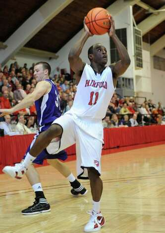 Fairfield's Desmond Wade looks to shoot during the Stags' victory over Holy Cross at Alumni Hall in Fairfield on Sunday, November 20, 2011. Photo: Brian A. Pounds / Connecticut Post