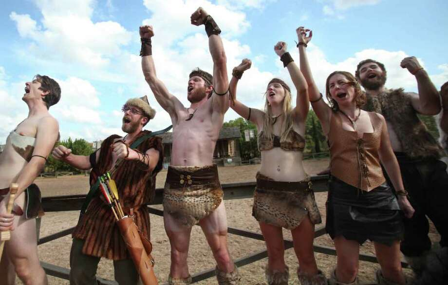 Participants growl during the Best Dressed Barbarian Contest at the Renaissance Festival on Sunday, Nov. 20, 2011, in Plantersville. Photo: Mayra Beltran, Houston Chronicle / © 2011 Houston Chronicle