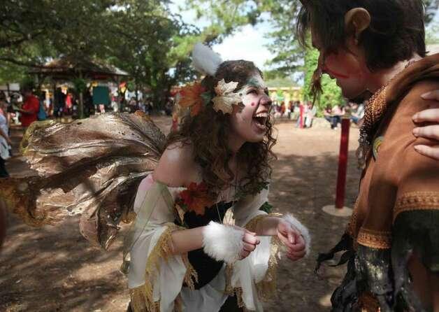 """Aspen Fairy"" Miranda Adams, 17, and ""Puck"" Tyler Cook, 21, share a laugh at the Renaissance Festival on Sunday, Nov. 20, 2011, in Plantersville. Photo: Mayra Beltran, Houston Chronicle / © 2011 Houston Chronicle"