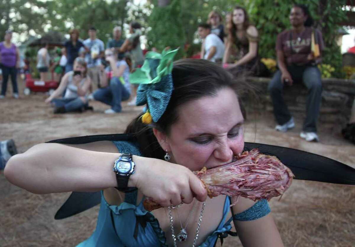 Heather Mann, 25, of Magnolia, chows down on a turkey leg during the