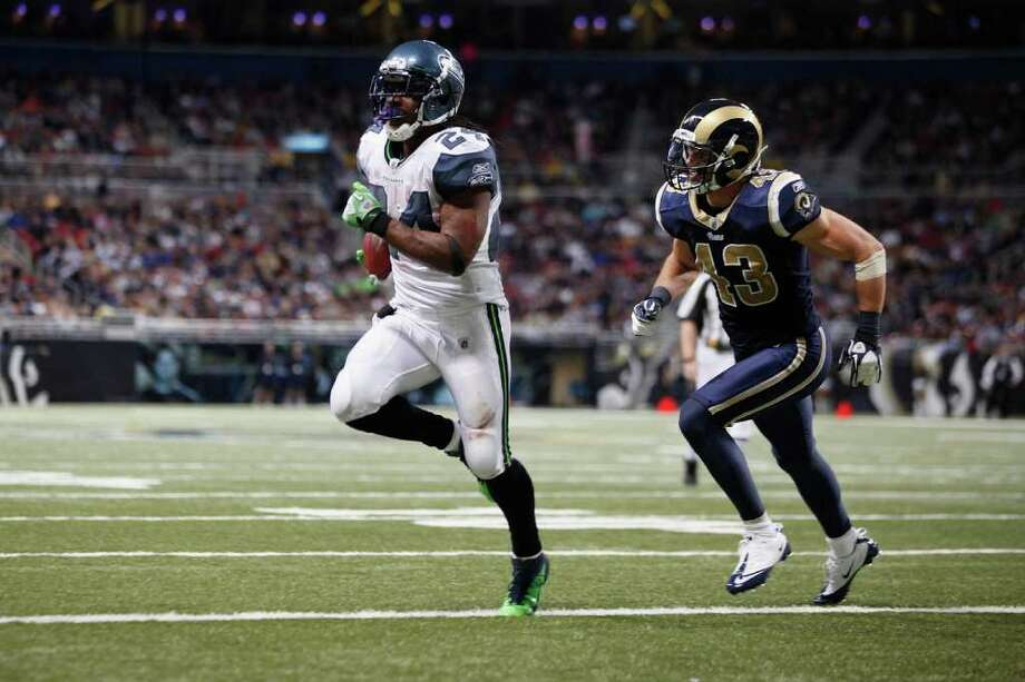 ST. LOUIS, MISSOURI - NOVEMBER 20:  Seattle Seahawks running back Marshawn Lynch #24 runs in for a touchdown ahead of St. Louis Rams safety Craig Dahl #43 in the second half of the game November 20, 2011 at the Edward Jones Dome in St. Louis, Missouri. Photo: Whitney Curtis, Getty Images / 2011 Getty Images