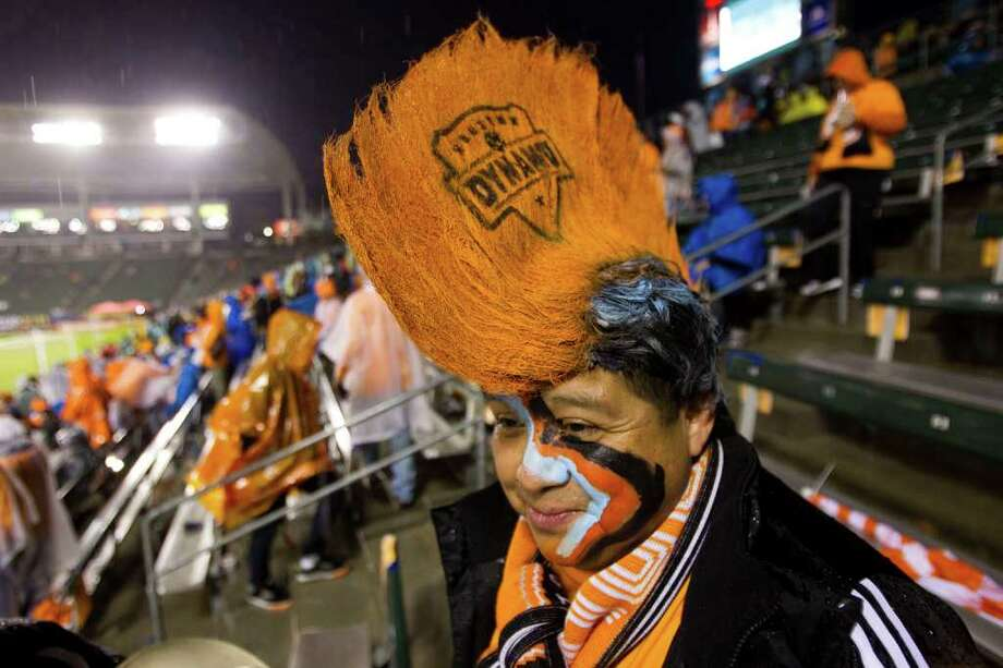 Houston Dynamo fan Jose Trejo sports an orange mohawk before the first half of the MLS Cup soccer match between the Dynamo and the Los Angeles Galaxy at the Home Depot Center Sunday, Nov. 20, 2011, in Carson, Calif. Photo: Brett Coomer, Houston Chronicle / © 2011 Houston Chronicle