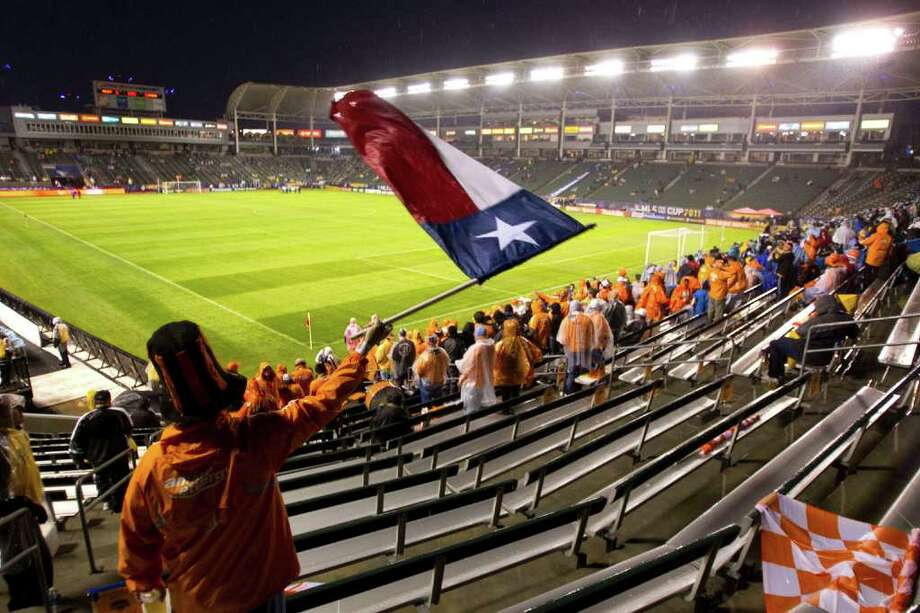 Houston Dynamo fan Bryan Hayman waves a Texas flag before the first half of the MLS Cup soccer match between the Dynamo and the Los Angeles Galaxy at the Home Depot Center Sunday, Nov. 20, 2011, in Carson, Calif. Photo: Brett Coomer, Houston Chronicle / © 2011 Houston Chronicle