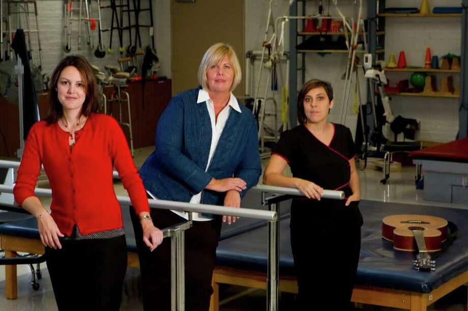 Brett Coomer: Houston Chronicle PART OF GIFFORDS' TEAM: Speech pathologist Kelley Warren Kirst, left, Dawn Phillips, occupational therapy assistant, and Meagan Morrow, music therapist, at TIRR (The Institute for Rehabilitation and Research) are part of a big team helping Rep. Gabrielle Giffords. Photo: Brett Coomer / © 2011 Houston Chronicle
